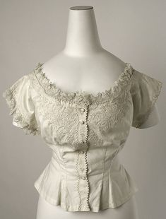 Corset Cover, 1870s, cotton, The Met...   Corset covers were used to protect fragile gowns from the steel and boning and fasteners of corsets.