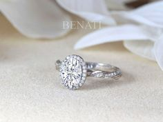 Exclusive to Benati.  A unique oval cut moissanite halo engagement ring with leaves on the band. Leaf Wedding Band, Diamond Wedding Bands, Boho Wedding, Wedding Rings, Oval Halo Engagement Ring, Elegant Engagement Rings, Diamond Anniversary Rings, Antique Rings, Nature Inspired