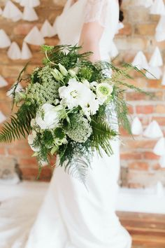 Organic bouquet with white blooms, wispy ferns, and Queen Anne's lace | Photo by Brooke Stapleton | Floral design by Julia Smith