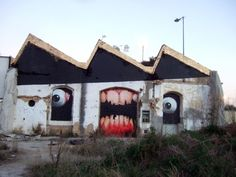 Graffiti : Mural painted in a lost place by the German artist Tasso