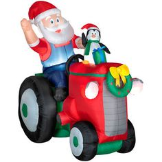 Gemmy Airblown Inflatable Animated Santa with Penguin On Tractor
