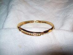 Goldtone bangle with cz or rhinestones, vintage goldtone bangle, bracelet signed O.S. by vintagebyrudi on Etsy