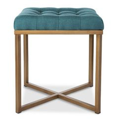 This chic Button Tufted Ottoman adds style and comfort to any room at an affordable price. Metal legs feature a gold finish. $59.99. Buy here.