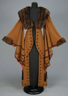WOOL COAT with APPLIQUE and FUR TRIM, EARLY C. Light brown with exaggerated wizard sleeve appliqued in darker brown with black silk tassels, fur collar and cuff, contrasting faux button trim and satin lining. Perhaps not for everyday Retro Mode, Mode Vintage, Vintage Coat, Looks Vintage, Antique Clothing, Historical Clothing, Fur Clothing, Steampunk Clothing, Clothing Styles