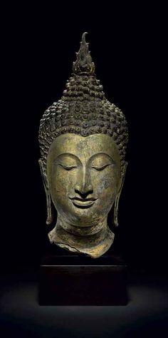 A GILT BRONZE HEAD OF BUDDHA