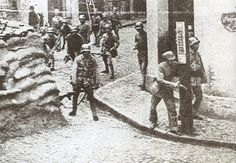 Soldiers of Chinese 88th Division gathering at a street corner in Shanghai, China, 1937