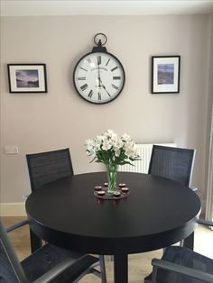 Dulux Gentle Fawn, giant clock, and Cornwall prints by Dave Crocker. Dining room idea