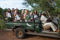 Bridesmaids in Safari Jeep   Photo: Greg Lumley. View More: https://www.insideweddings.com/news/planning-design/adventurous-real-wedding-at-a-game-reserve-in-south-africa/3336/