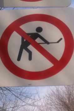Canadian street sign. Playing hockey in the streets was part of a normal winter day.