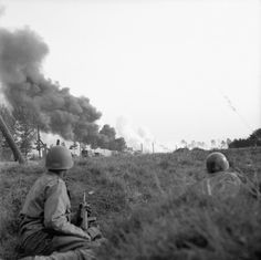 US paratroopers taking cover as German artifllery hits an XXX Corps convoy near Eindhoven/20 September 1944. Once Upon a Time in War