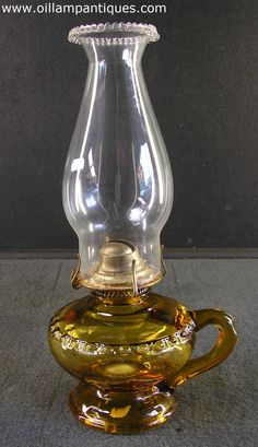 Amber glass pedestal finger oil lamp