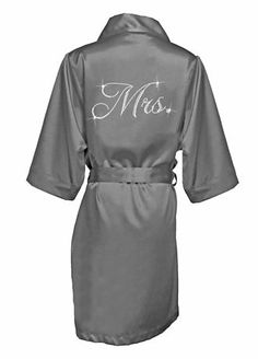 """Wrap the new Mrs. in luxury by giving her this gorgeous silky satin robe embellished with dazzling rhinestones in an elegant script Mrs. design.  Features and Facts:  Robe is embellished with the""""Mrs"""" in rhinestones on the back.  Includes a self-fabric belt and inside ties.  Material: 98% polyester / 2% spandex for a bit of comfortable stretch (exclusive of embellishment).  Hand-wash cold and line dry."""