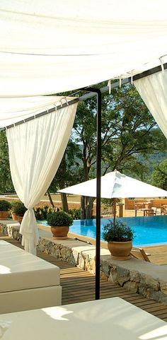 Sunloungers by the swimming pool at the Son Brull Hotel & Spa in Mallorca, Spain