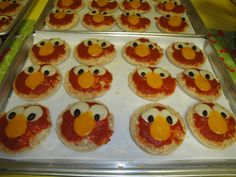 Elmo pizzas for my son's 2-yr. birthday! My mom's idea: English muffins topped w/ mozzarella, then sauce, w/ eyes and nose cut from cheese, and black beans for the eye centers. Adorable and tasty!!