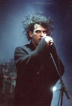 Robert Smith of The Cure...I remember lots of indie boys and girls copying the sleeves over hands look..