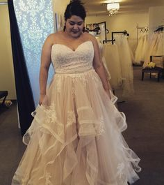 This strapless plus size wedding dress has a lace empire waist bodice.  The a-line skirt features a textured hem.  Curvy brides can have plus size wedding dresses like this customized to their personal taste & style. We are US dressmakers who specialize in totally custom wedding gowns & #replicas of designer dresses too.  Contact us for details at www.dariuscordell.com