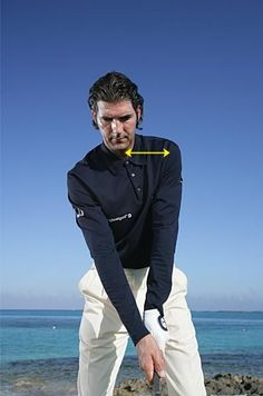 For longer golf shots and fewer slices, move your left shoulder
