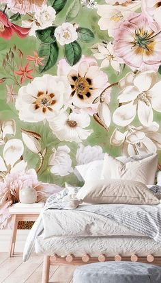 Bring the outdoors in and adorn your walls with beautiful blooms and fresh greenery through this stunning floral mural. Featuring beautiful shades of green, light baby pink and neutral tones, this floral mural is the perfect addition to your pretty pastel bedroom. Paired with a Scandi style, light wooden bed, white and pastel shade bedding and white walls, this interior is the definition of bright home decor. Get the look at Wallsauce.com! #bedroomdecor #bedroominspo