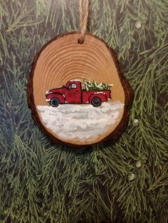 Wood slice Christmas ornament red truck in snow hand-painted Approx. 3 inches drilled hole with twine for hanging Beautiful sliced wood perfect for a rustic feeling hand-painted antique truck carrying a Christmas tree in the snow ornament. Willing to make multiples/message for Christmas Ornaments To Make, Rustic Christmas, Christmas Projects, Christmas Art, Holiday Crafts, Christmas Decorations, Painted Ornaments, Wooden Ornaments, Diy Weihnachten