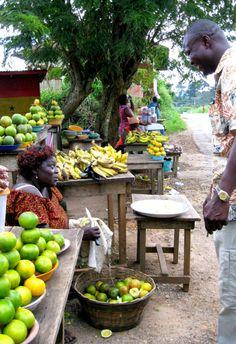 Buying oranges on the road to Kumasi, Ghana