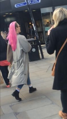 pink hair, trench coat.