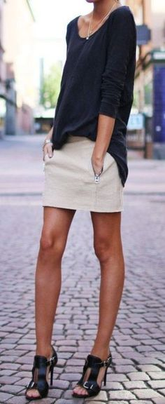 Black v neck sweater, khaki mini skirt, black heels