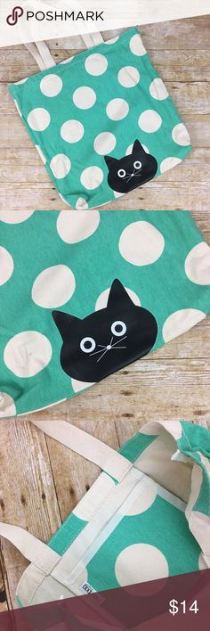 Cute Cat Peek-a-boo Tote Bag Cute Cat Peek a boo Tote Bag. 1 pocket inside.  9 inch drop on handle. Feels like canvas. 100% cotton Mixed Bag Designs Bags Totes