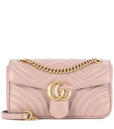 GUCCI - GG Marmont matelassé leather crossbody bag - Gucci's GG Marmont shoulder bag has been crafted in Italy from quilted matelassé leather for a chevron finish. The softly structured shape is adorned with the brand's iconic GG hardware for instant recognition – a signature that really stands out next to the cappuccino-hued leather. Tote your essentials in its faux suede-lined interior and adjust the sliding chain strap for a longer or shorter drop. - @ www.mytheresa.com