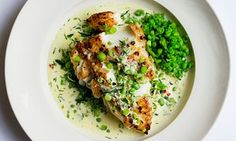 cod with chilli and pea purée on a round plate