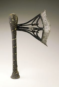 Iron blade with three bands of metal joining a curving edge, enclosing two twisted interior strands that entwine with the inner looped side of the blade. The central s … Reptile Skin, Human Head, Male Figure, National Museum, Republic Of The Congo, African Art, Rhodes, Metal, Strands