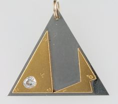 LOT 671, A triangular yellow gold and white metal pendant set a mine cut diamond SOLD £300
