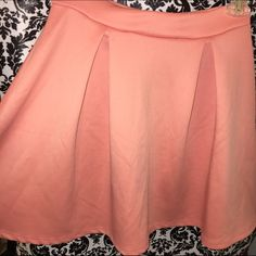 Charlotte Russe Skirt Circle Skater Skirt. Pink / Peach Color. I provided pictures with & without flash. Size small from Charlotte Russe. Its in good condition. Theres very light marks, that I cant tell if its part of the lint from being with my clothes or not, so its in good condition, not like new because of that. Charlotte Russe Skirts Circle & Skater