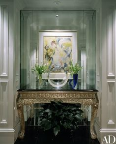 """Elton John's apartment in Atlanta, designed by Stan Topol and Fred Dilger, now serves as his base in the U.S. because """"I feel very relaxed there."""" Topol and Dilger placed an untitled 1970 Willem de Kooning oil in a niche in the entrance hall   archdigest.com"""