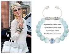 Paris Hilton wearing a NIALAYA Signature Lock 925 Solid Silver Logo Ball 925 Solid Silver 7 mm Aquamarine 10 mm Blue CZ Silver Base 10 mm £188