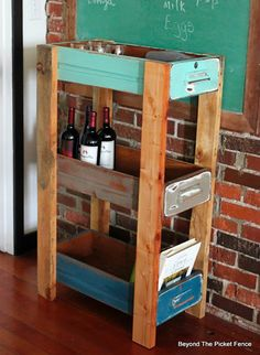 This Upcycled Drawer Shelf created over at Beyond The Picket Fence is Farmhouse Industrial Chic.  Check it out and see how a pallet base was created and then the drawer added.  You will get tons of ideas that you can implement on your next upcycle. . . Really loving this because anyone can do it …