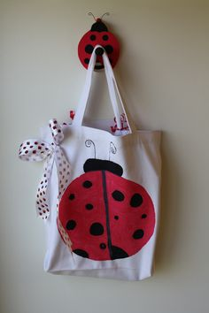 Ladybug Birthday Bag. A journal and a birthday themed book are in the bag for a student to take home and do with their family on their birthday