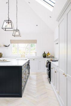 5. Light hardwood floors in a herringbone pattern lighten up this Real Shaker Kitchen by deVOL