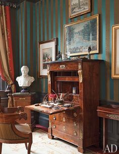 Brockschmidt & Coleman ~ An Empire secrétaire à abattant and a bust of Napoléon stand in the guest room; the walls are covered with a Claremont stripe. (photo: Roger Davies)
