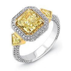 Natureal Collection Platinum and 18K Yellow Gold Radiant-Cut Fancy Yellow Diamond Engagement Ring LVS515 - This ring features a gorgeous platinum and 18K yellow gold single shank with perfect radiant-cut fancy yellow diamond with a total weight of 1.74 carats.  The ring is complimented with 2 trapezoid  fancy yellow diamond sidestones with a total weight of .06 ct. and 182 round white diamonds with a total weight of .50 ct.