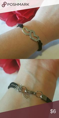 Basic double hearts bracelet Made up of alloy metal faux leather cord band and connects with a white nickle chain with double ring fasteners with a metal.Lobster clasp. Jewelry Bracelets