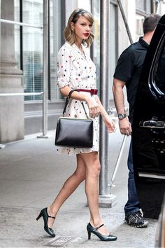 Seriously, the headband and the shoes match perfectly! Taylor out in NYC May 2nd wearing Zooey Dechanel's new dress from her new line!