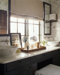 McAlpine Booth & Ferrier Interiors Beachfront Warmth - McAlpine Booth & Ferrier Interiors.  marble, faucets, cabinet color with the marble, mirrors, shades