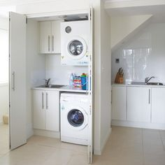 A compact laundry is installed in a cupboard under stairs Laundry Cupboard, Utility Cupboard, Laundry Nook, Small Laundry Rooms, Laundry Closet, Laundry Room Storage, Cupboard Storage, Laundry In Bathroom, Cupboard Ideas