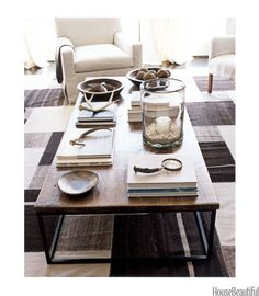 What a great mix of neutrals and earth tones on this rustic coffee table.