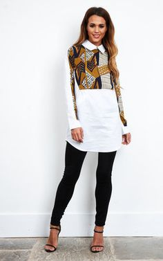 We love the contrasting prints and relaxed fit of this shirt dress. Perfectly paired bare legs and a block heel or jeans and cute flats. The dress features an androgynous collar and long sleeves.