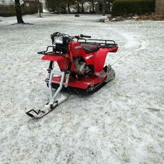 Very cool custom Honda ATC Big Red 3 wheeler with track and a snow blade.  Very cool