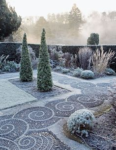 Arabella Lennox-Boyd, one of England's leading garden designers, has established a multitude of inspiring spaces at Gresgarth, the Lancashire home she shares with her husband, former politician Sir Mark Lennox-Boyd. One area (shown frosted by winter) features a swirling pavement of pebbles dappled with stone stars and zodiacal signs (not shown) relating to the Lennox-Boyd family; Maggy Howarth, a mosaic artist, did the honors.