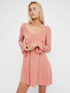 Come And Catch Me Long Sleeve   Long sleeve top with a super comfy fabrication and an easy, scooped neckline. Sleeves feature an adjustable tie at the cuffs with cute vented detailing. Effortless, relaxed shape with a slight high-low hem.