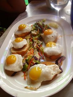 fried quail eggs over slices of chorizo Tapas Party, Quail Eggs, Seville, Sangria, Chorizo, Stuffing, Fries, Spain, Owl