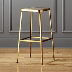 """Shop flint gold 24"""" counter stool. Factory-inspired stool parks square at the bar in flint steel with a glam gold finish and exposed welding. Legs flare refined, love those little capped feet. Each a handcrafted original."""